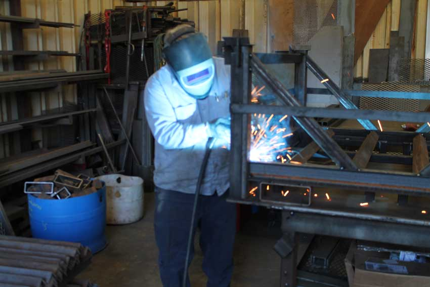 Welder fabricating a project for a customer.